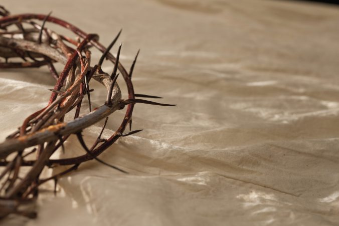 Crown of thorns on white linen